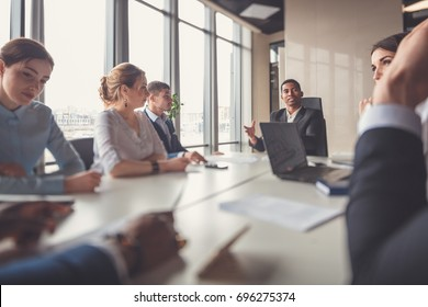 Businessman presenting to colleagues at a meeting