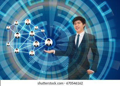 Businessman presenting his business plan of his network marketing MLM business on the virtual screen and leading to the upcoming globalization and technology in the future