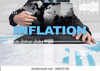 Businessman presenting inflation concept.