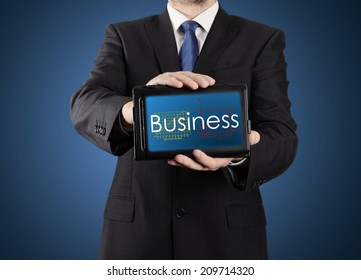 businessman presenting something on tablet - business