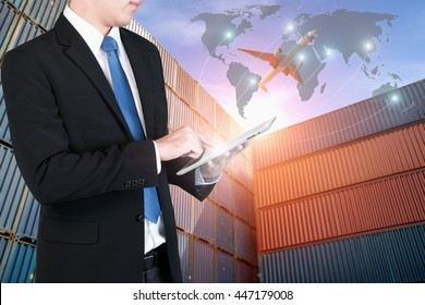 Businessman press digital tablet to show global network partnership connection use for logistic,import,export background.(Elements of this image furnished by NASA)