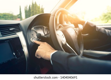 Businessman press start  button in the car