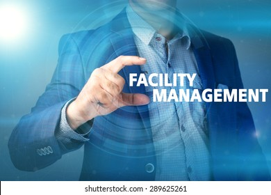 Businessman presses button facility management on virtual screens. Business, technology, internet and networking concept.
