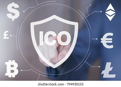 Businessman presses button ICO Initial Coin Offering shield security virus currency on virtual digital electronic user interface.