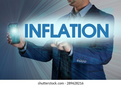 Businessman presses button inflation on virtual screens. Business, technology, internet and networking concept.