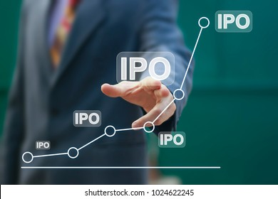 Businessman presses button ipo Initial Public Offering network on chart.