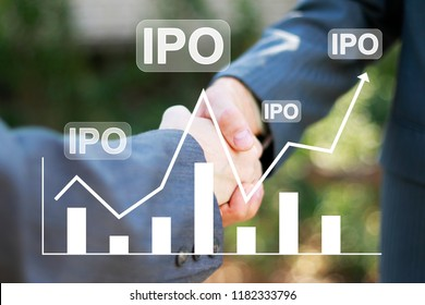 Businessman presses button ipo Initial Public Offering icon network on chart. Two coworkers handshaking process of interaction.