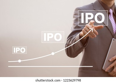 Businessman presses button ipo Initial Public Offering on virtual chart.