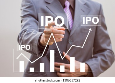 Businessman presses button ipo Initial Public Offering on virtual digital interface chart.