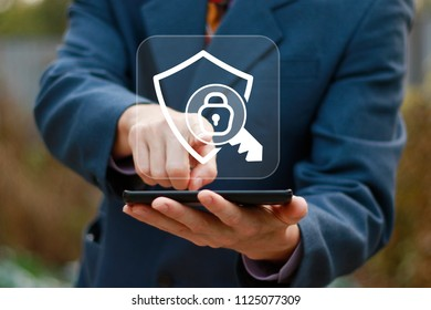 Businessman presses button locked shield security icon on phone virtual electronic user interface