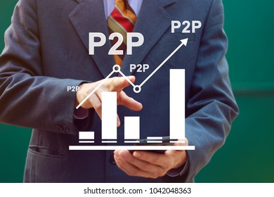 Businessman presses button p2p Peer-to-peer on chart.