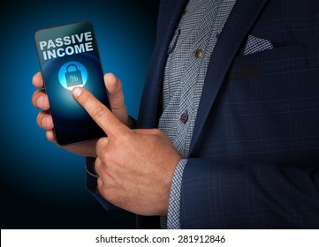 Businessman presses a button touch screen passive income smatrfona. Business, technology, internet and networking concept