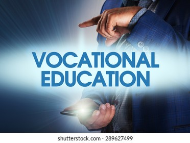 Businessman presses button vocational education on virtual screens. Business, technology, internet and networking concept.
