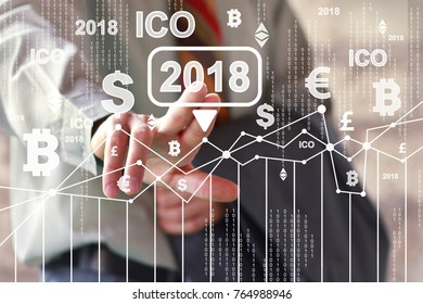 Businessman presses currencies button ICO Initial Coin Offering 2018 chart diagram on virtual digital electronic user interface.