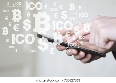 Businessman presses currencies button on phone ICO Initial Coin Offering on virtual user interface account.