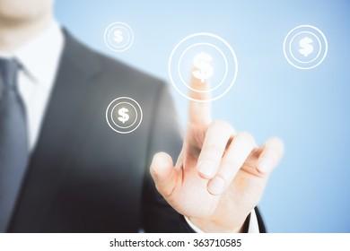 Businessman presses digital interface dollar sign bottom