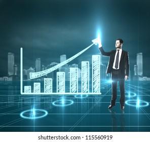 businessman presses sheme  growth chart