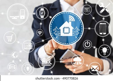 Businessman presses smart home icon with microchip. Businesswoman touched house sign with chip symbol and wifi. Business, automation, web, network devices. Internet of things, iot technology, wireless