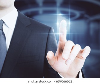 Businessman pressing abstract digital button on blurry background. Biometrics concept