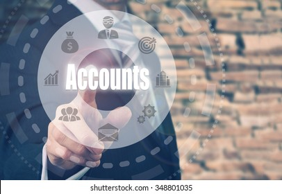 Businessman pressing an Accounts concept button.