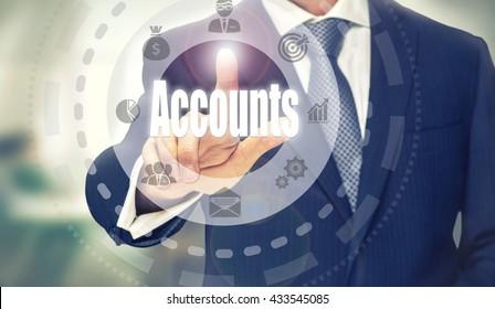 Businessman pressing an Accounts concept button.