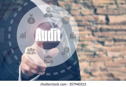 Businessman pressing an Audit concept button.