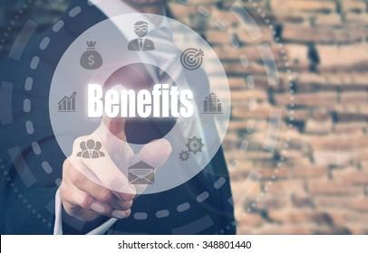 Businessman pressing an Benefits concept button.
