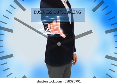 businessman pressing business outsourcing button on digital screens