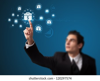 Businessman pressing business type of modern buttons with virtual background