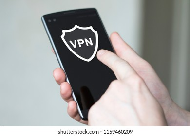 Businessman pressing button app vpn creation Internet protocols for protection private network on phone.