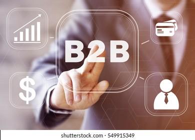 Businessman pressing button b2b network. Concept virtual b2b icon.