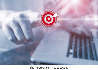 Businessman pressing button goal on digital virtual screen, Success concept, new technology and connection maps on the background.