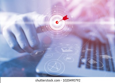 Businessman pressing button goal on virtual screen, Success concept, technology industry 4.0 and world maps on the background.