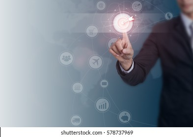 Businessman pressing button goal on virtual screen, networking concept.