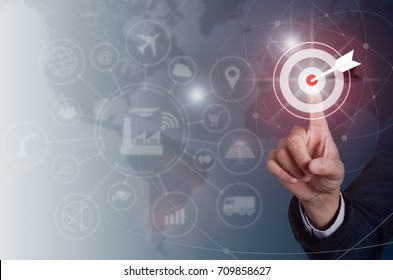 Businessman pressing button goal on virtual screen, Success concept, technology industry  and world maps on the background.
