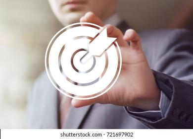 Businessman pressing button goal on virtual screen in networking concept.