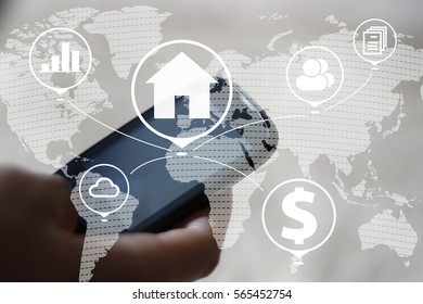 Businessman pressing button house home on smartphone network. Business communication on map.