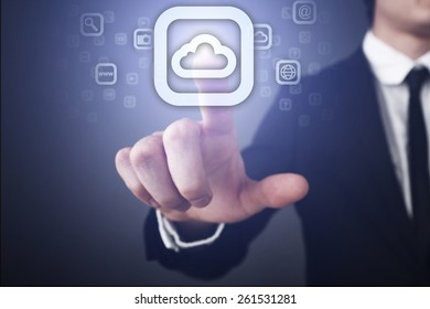Businessman pressing button on touch screen interface and select cloud icon. business concept. internet concept.