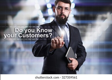 Businessman pressing button on touch screen interface and select Do you know your customer?. Business concept. Internet concept.