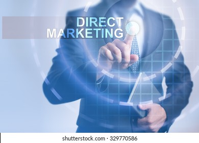 Businessman pressing button on touch screen interface and select Direct marketing. Business, internet, technology concept.