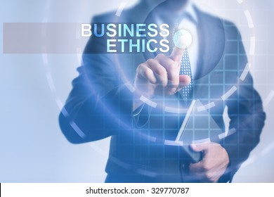 Businessman pressing button on touch screen interface and select Business ethics. Business, internet, technology concept.