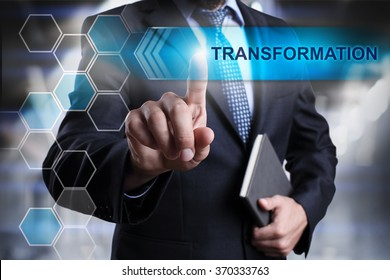 "Businessman pressing button on touch screen interface and select ""Transformation"". Business concept. Internet concept."