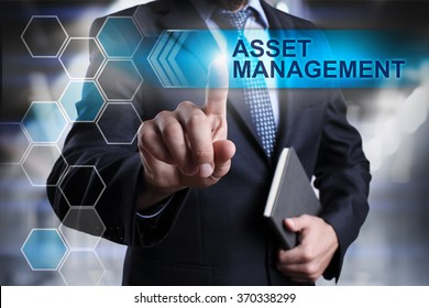 "Businessman pressing button on touch screen interface and select ""Asset management"". Business concept. Internet concept."