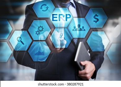 """Businessman pressing button on touch screen interface and select """"ERP"""". Business concept. Internet and technology concept."""