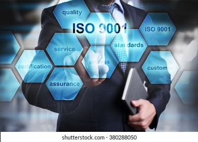 "Businessman pressing button on touch screen interface and select ""ISO 9001"". Business concept. Internet and technology concept."