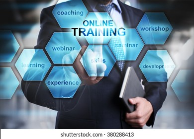 "Businessman pressing button on touch screen interface and select ""Online training"". Business concept. Internet and technology concept."