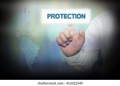 Businessman pressing button on touch screen interface and select PROTECTION. Business concept