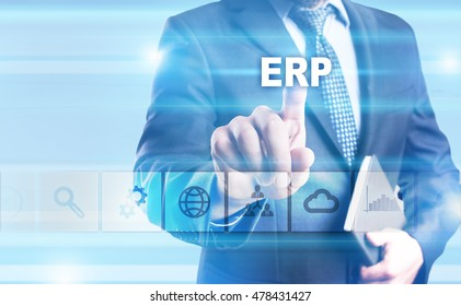 """Businessman is pressing button on touch screen interface and selecting """"ERP""""."""