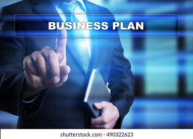 "Businessman is pressing button on touch screen interface and selecting ""Business plan"". Business concept."