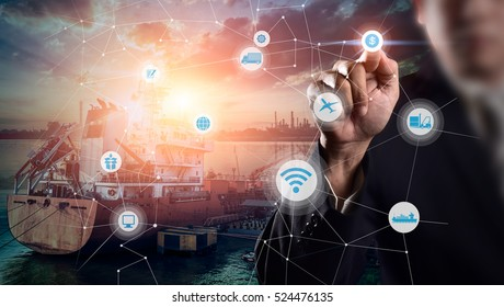 Businessman is pressing button on touch screen interface in front for Logistic Import Export background, Internet of Things concept